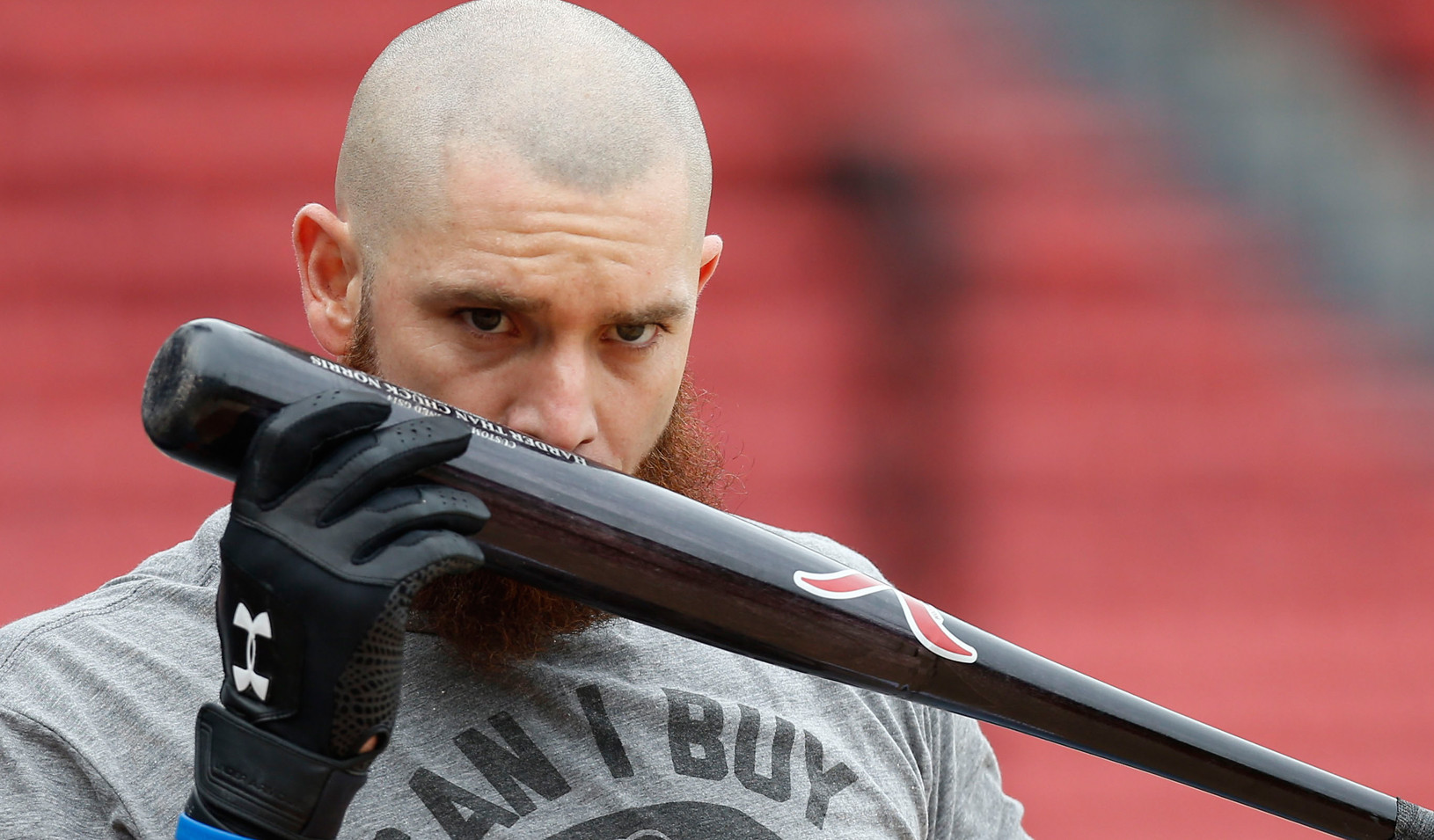 Red Sox left fielder Jonny Gomes kisses his bat during a team workout at Fenway Park, 2013 (USA Today Sports photo by Greg M. Cooper)