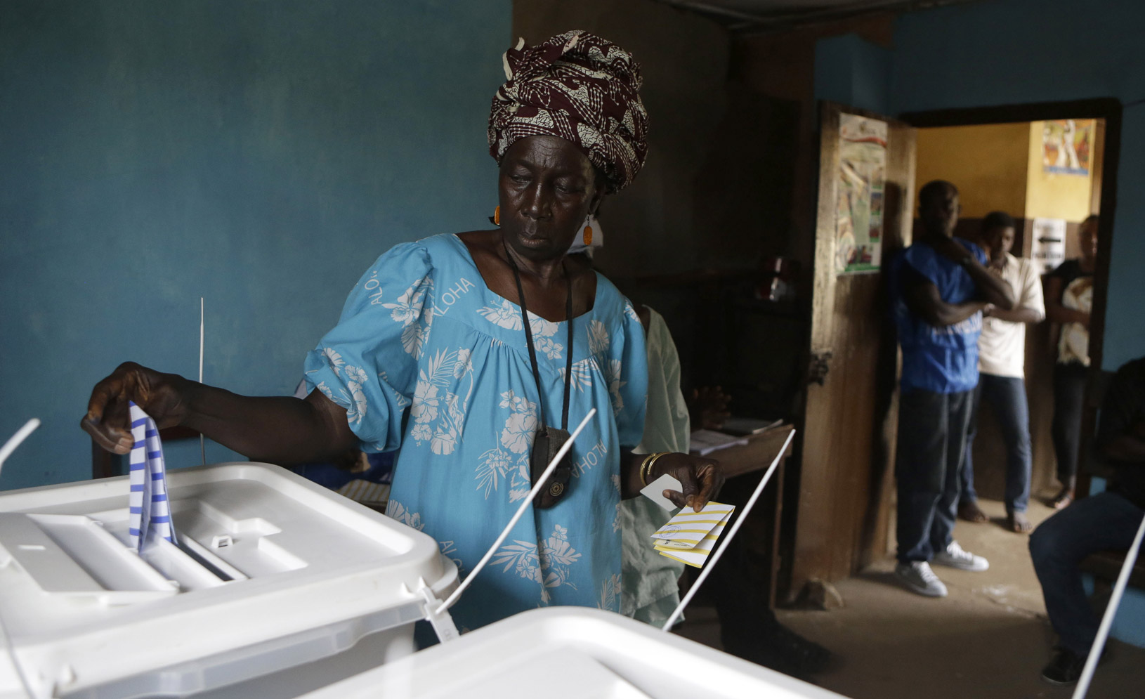 At a polling station in Freetown, Sierra Leone, a woman casts her ballot for president in the November 2012 elections.