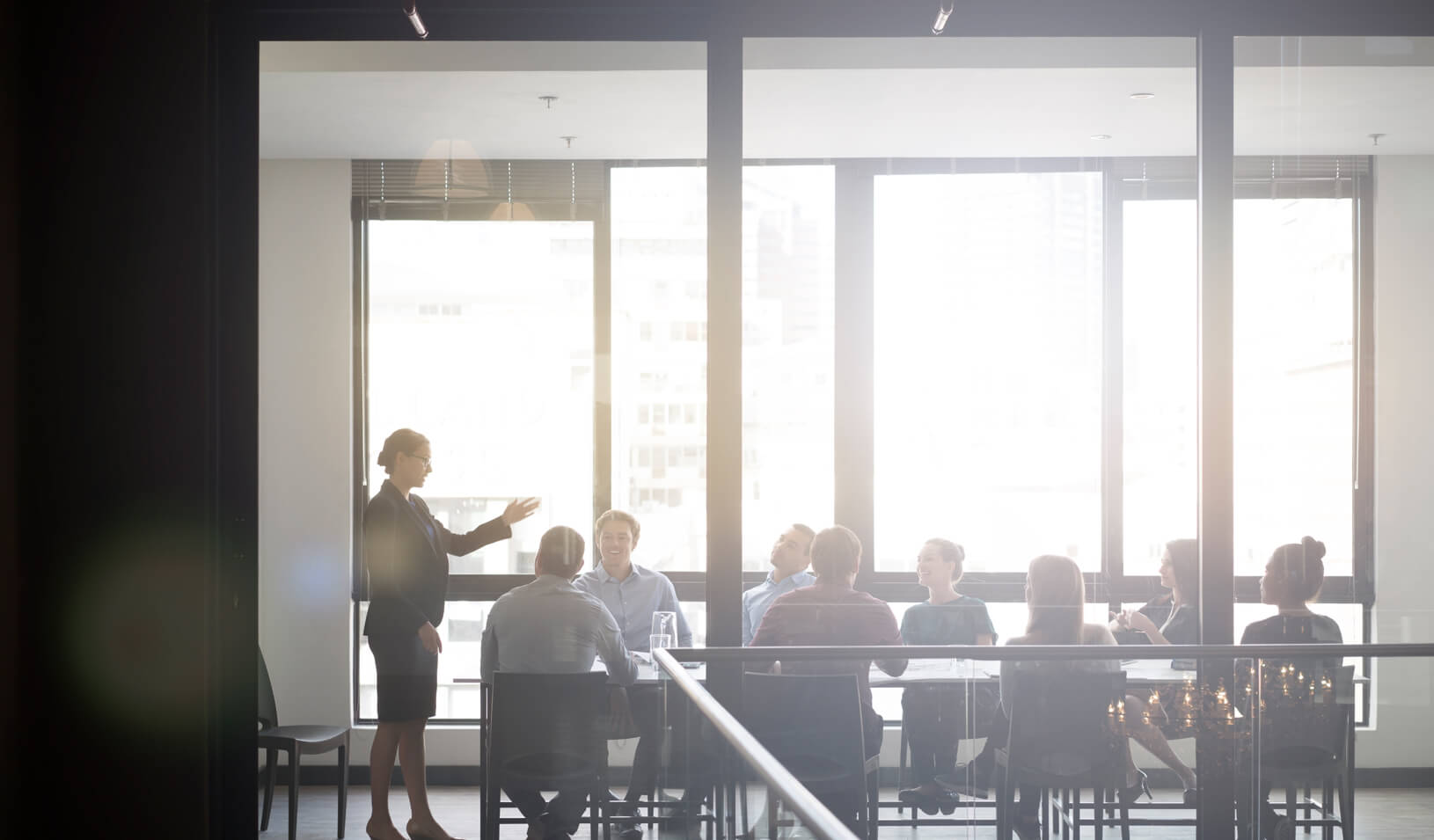 A woman presenting to colleagues. Credit: iStock/Portra