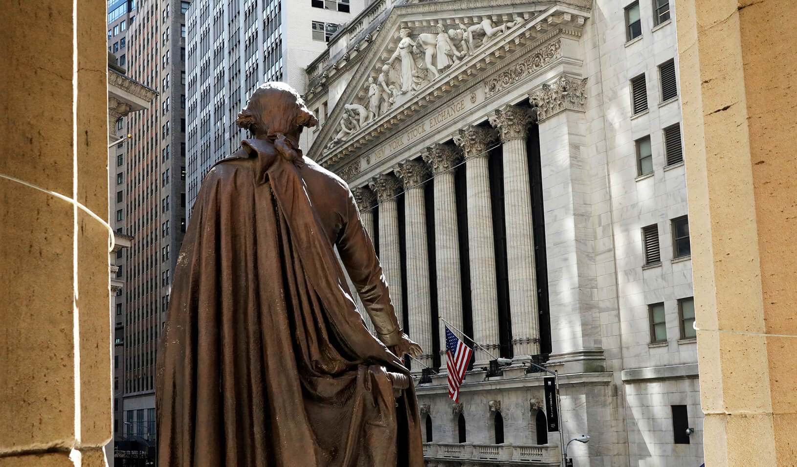 The New York Stock Exchange from the steps of Federal Hall behind a statue of former U.S. President George Washington. | Reuters/Brendan McDermid