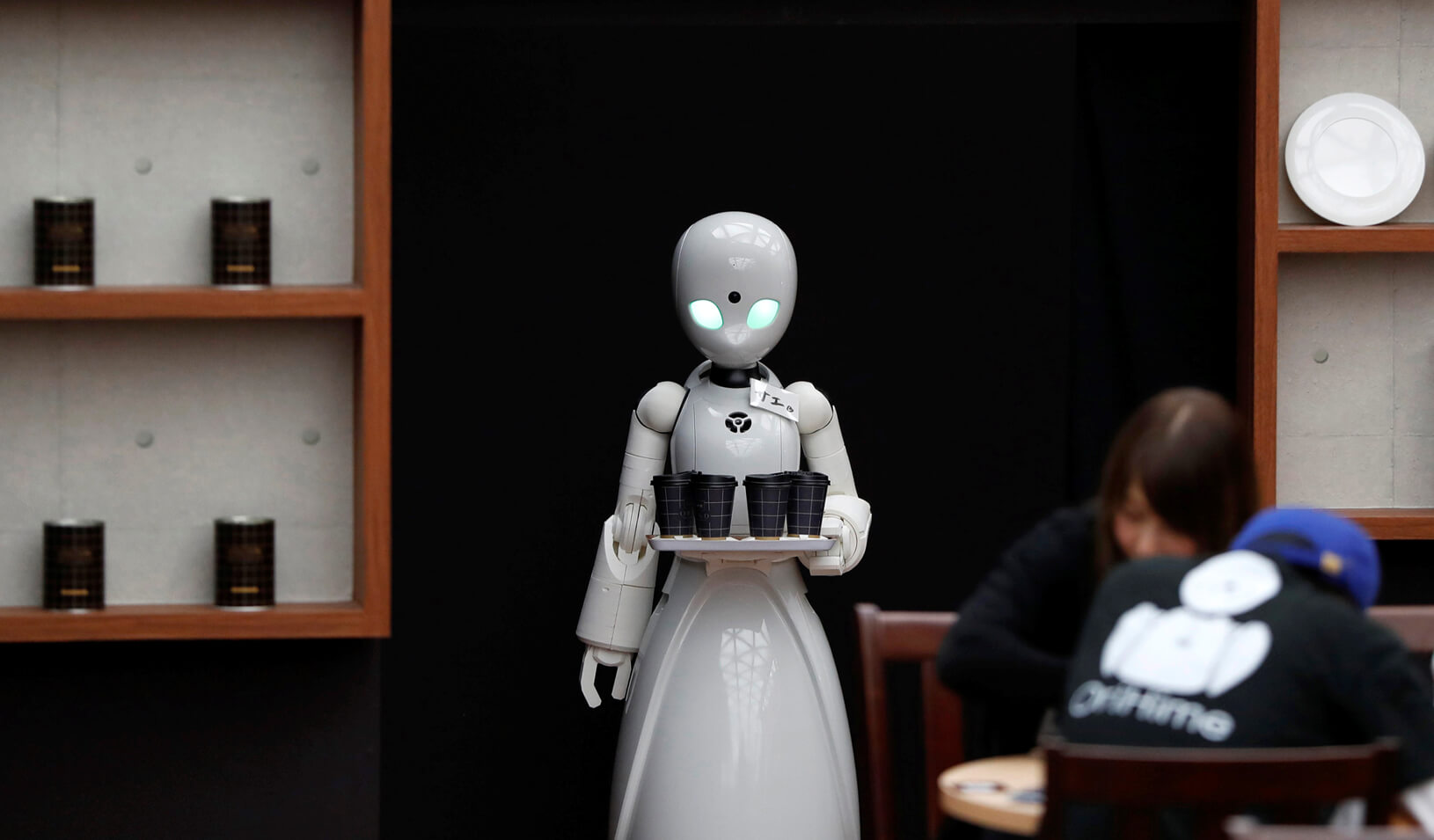Remotely controlled robots OriHime-D, developed by Ory Lab Inc. to promote employment of disabled people, serve customers at a cafe in Tokyo, Japan. Credit: Reuters/Issei Kato