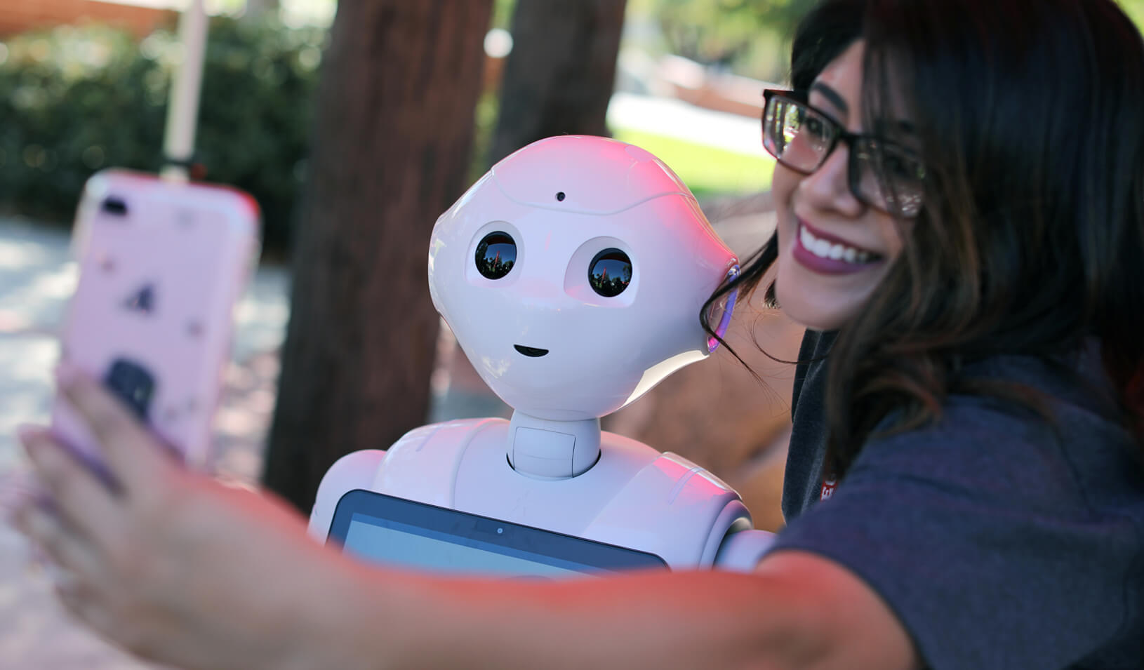 """San Marcos student Amaris Gonzalez takes a selfie with """"Pepper"""" an artificial Intelligence project utilizing a humanoid robot. 