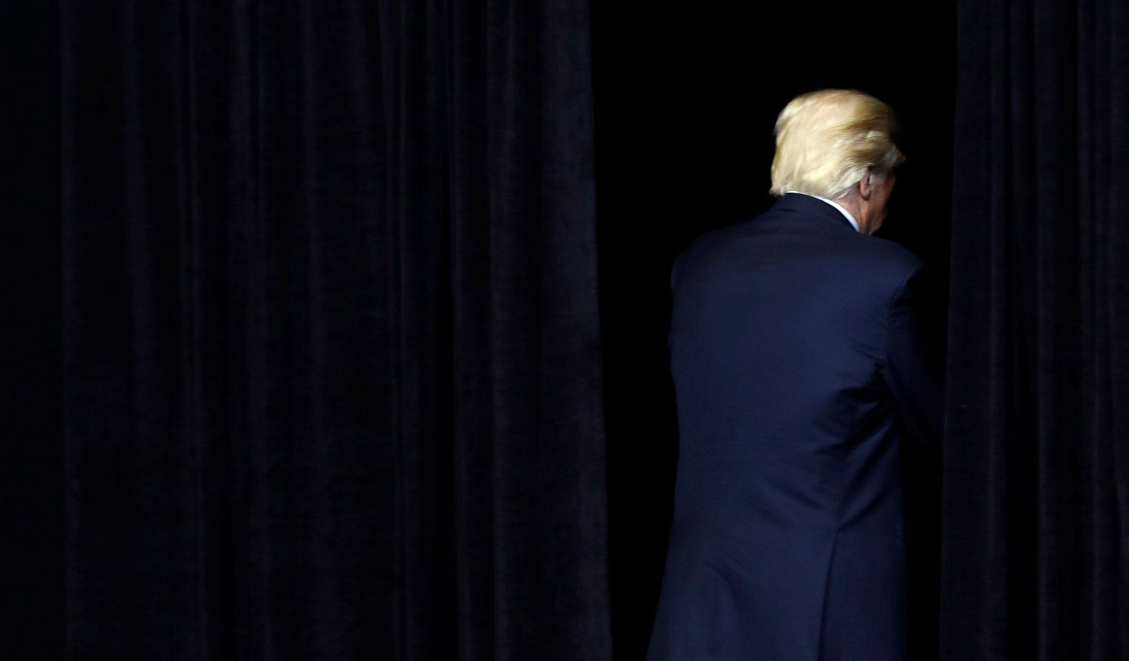 U.S. President Donald Trump exits the stage.