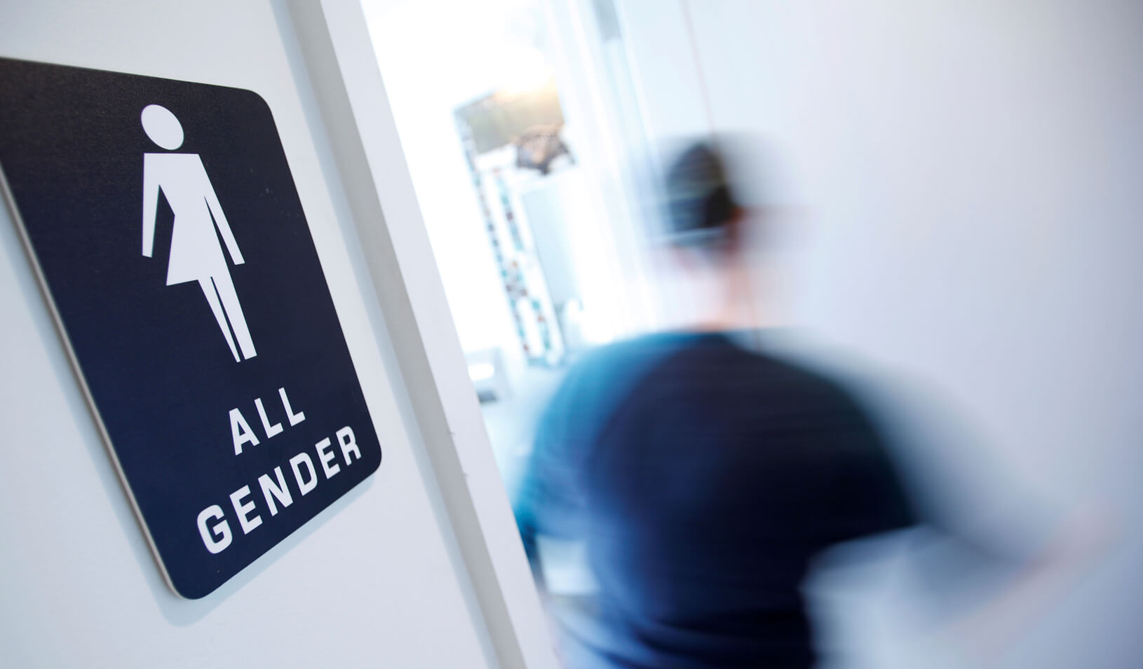 A bathroom sign welcomes both genders at the Cacao Cinnamon coffee shop in Durham, North Carolina, United States on May 3, 2016. | Reuters/Jonathan Drake