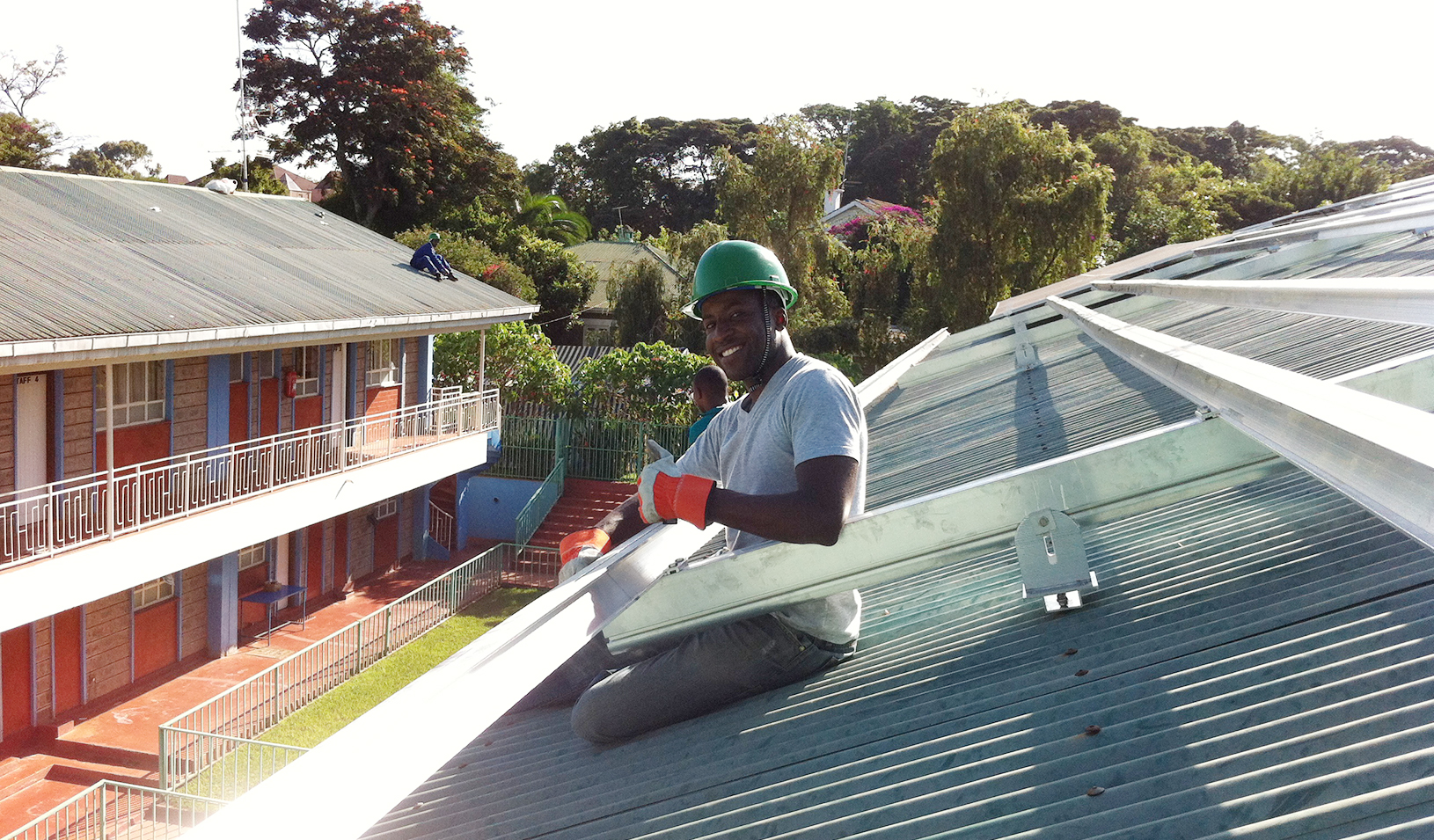 Aurora Co-founder Samuel Adeyemo works on a rooftop installation. | Courtesy of Samuel Adeyemo