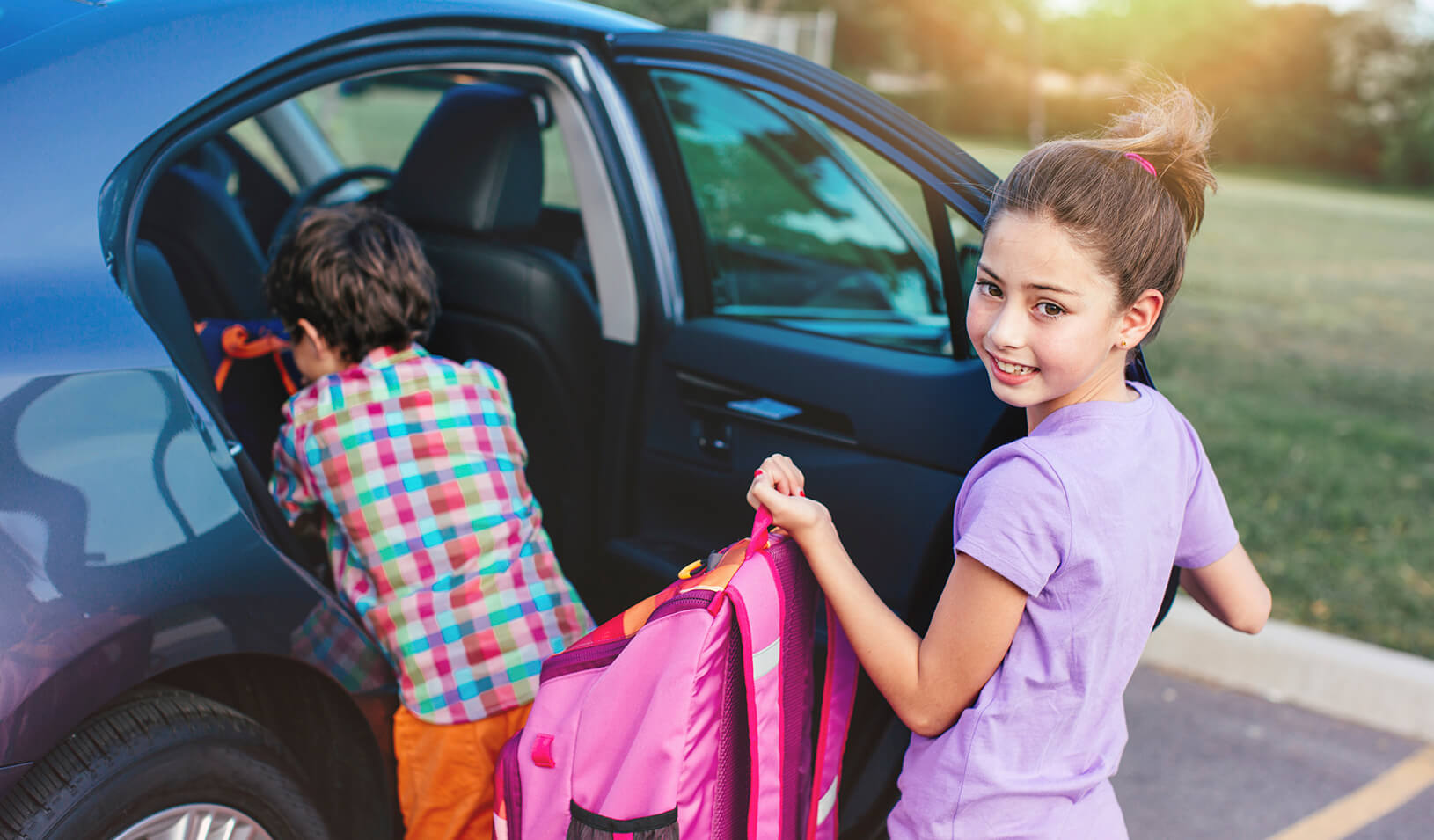 Kids getting into a car | iStock/kate_sept2004