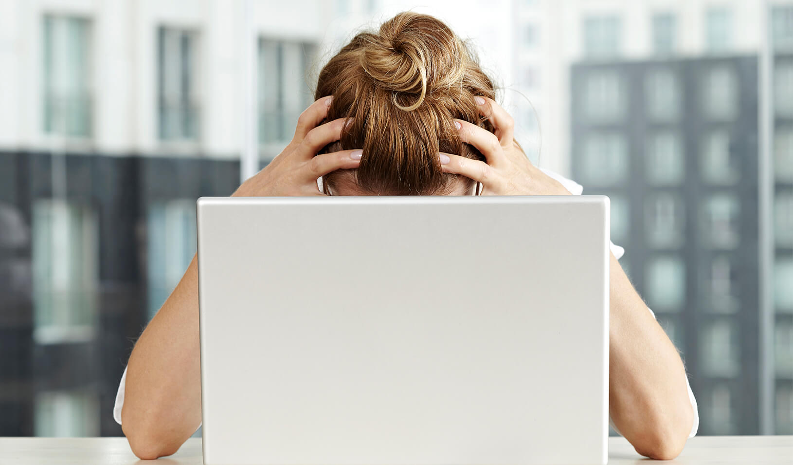 A woman is exasperated at a computer | iStock/aydinynr