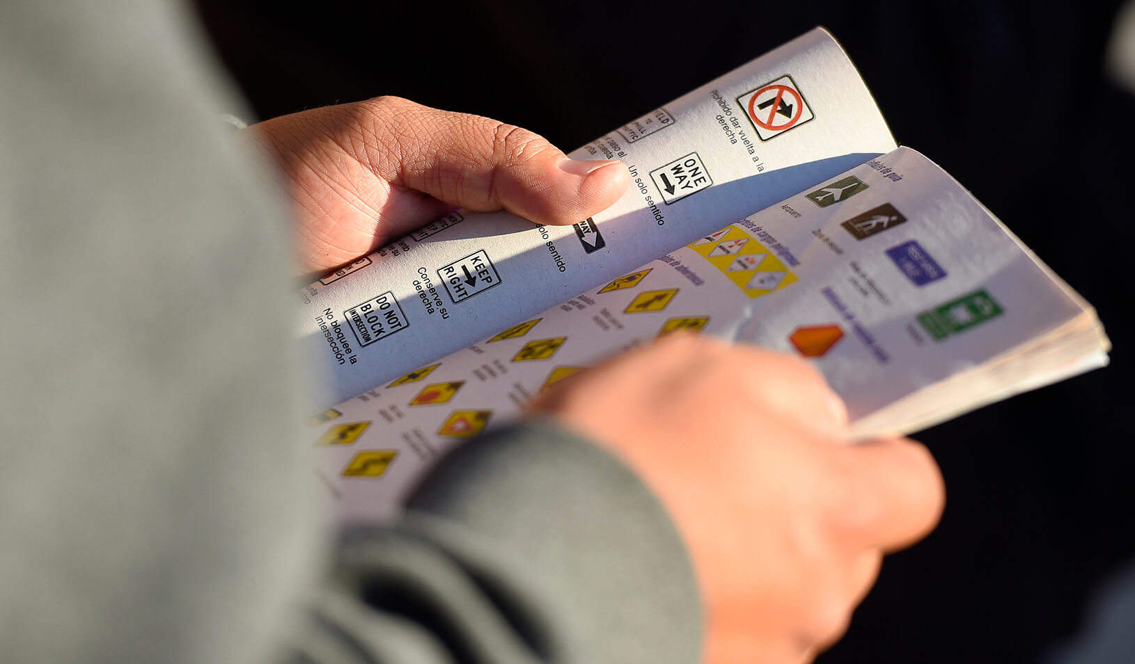 An applicant reviews a driving handbook | Reuters/Gus Ruelas