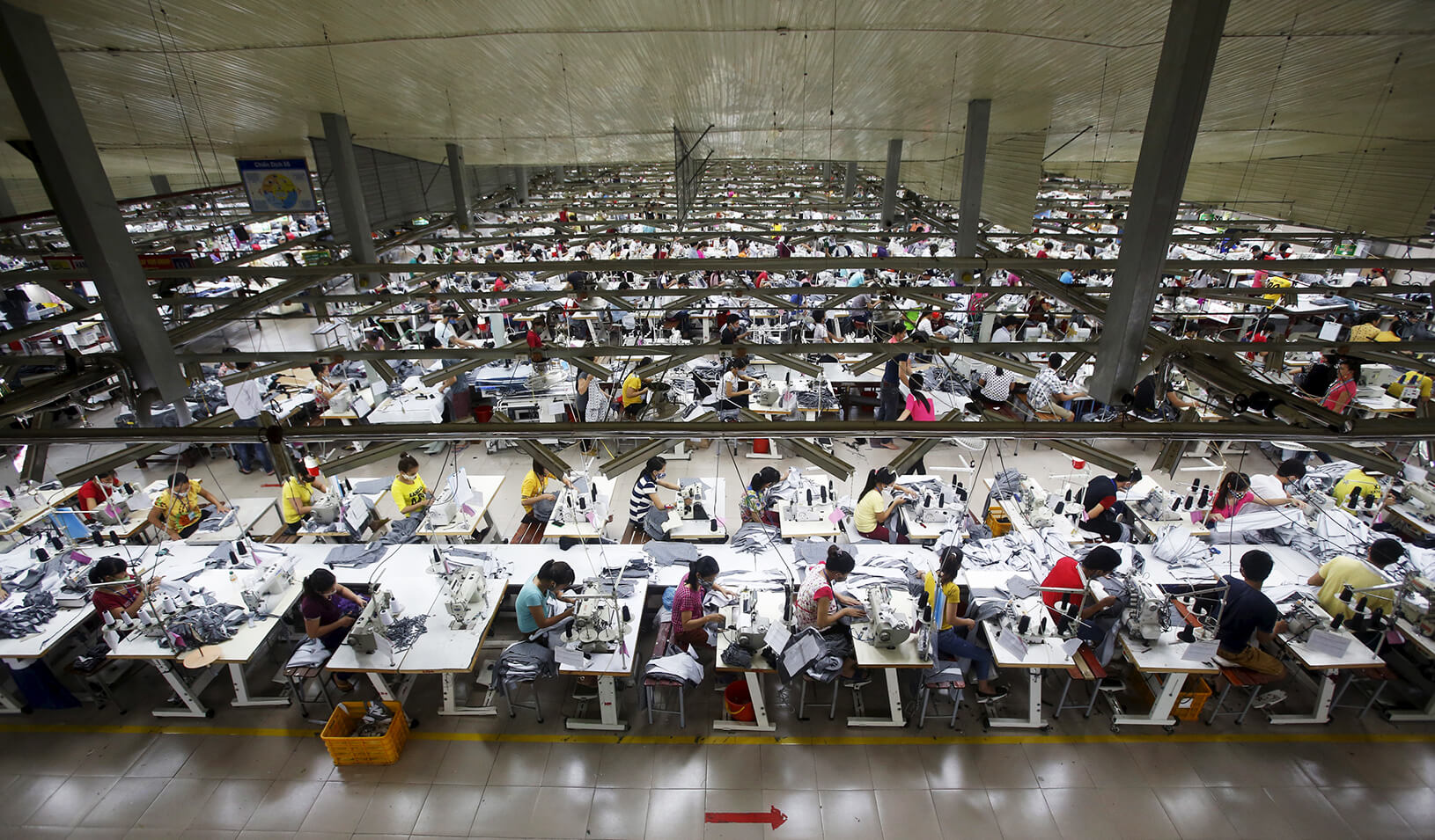 Labourers work at a large garment factory | Reuters/Kham