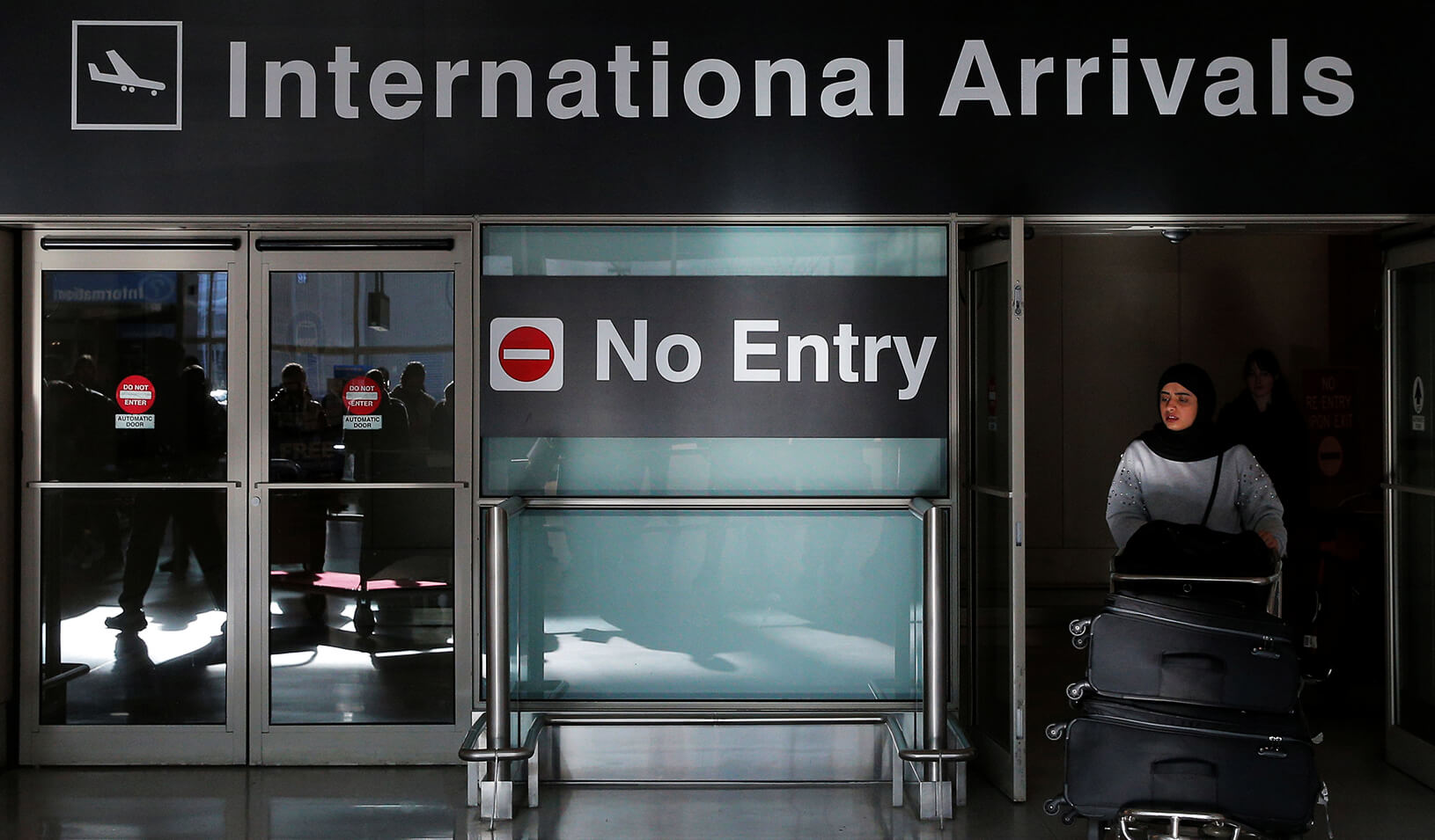 An international traveler arrives after U.S. President Donald Trump's executive order travel ban at Logan Airport in Boston, Massachusetts. | Reuters/Brian Snyder