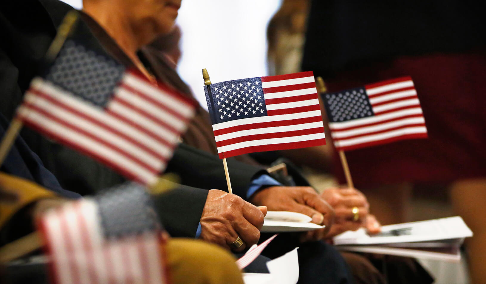 Immigrants partake in a naturalization ceremony to become new citizens of the U.S. | Reuters/Brendan McDermid