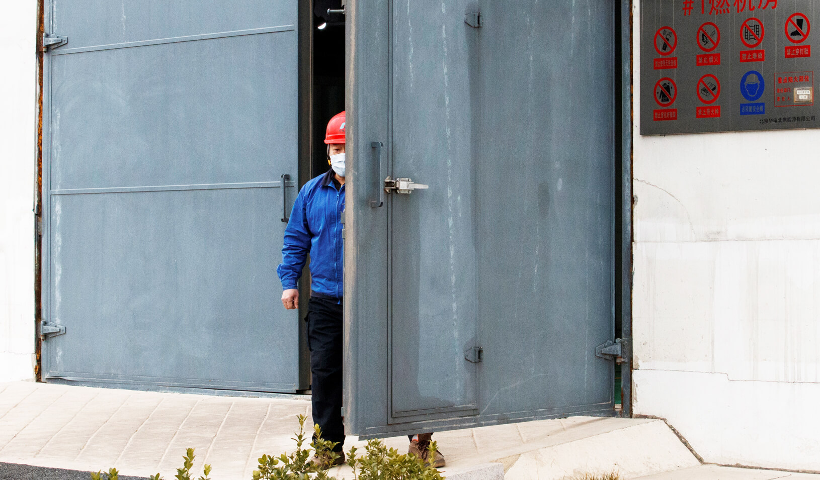A worker wearing a face mask is seen at a plant in Beijing as the country is hit by an outbreak of the novel coronavirus. Credit: REUTERS/Thomas Peter