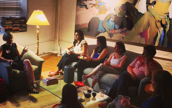 Photo of women holding a discussion