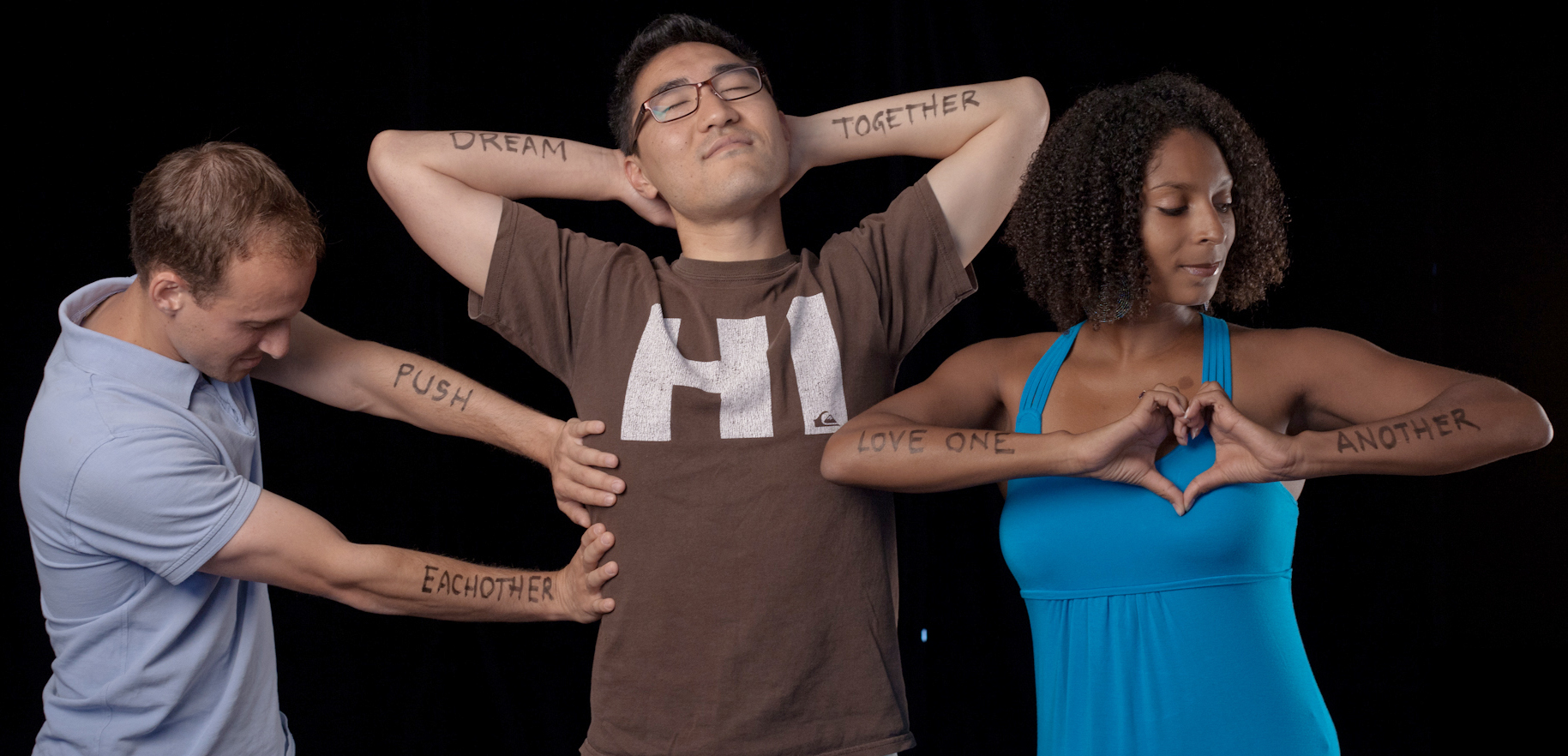 Students with writing on arms: Push each other; Dream together; Love one another