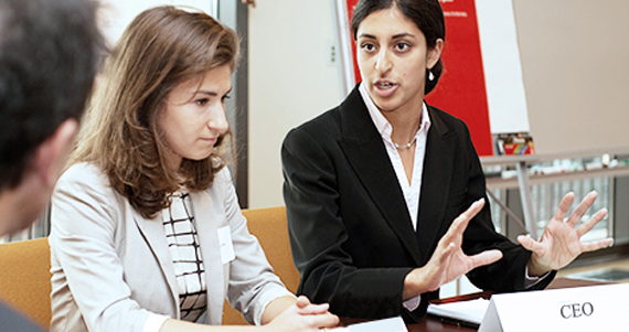 Two women participating in executive challenge session