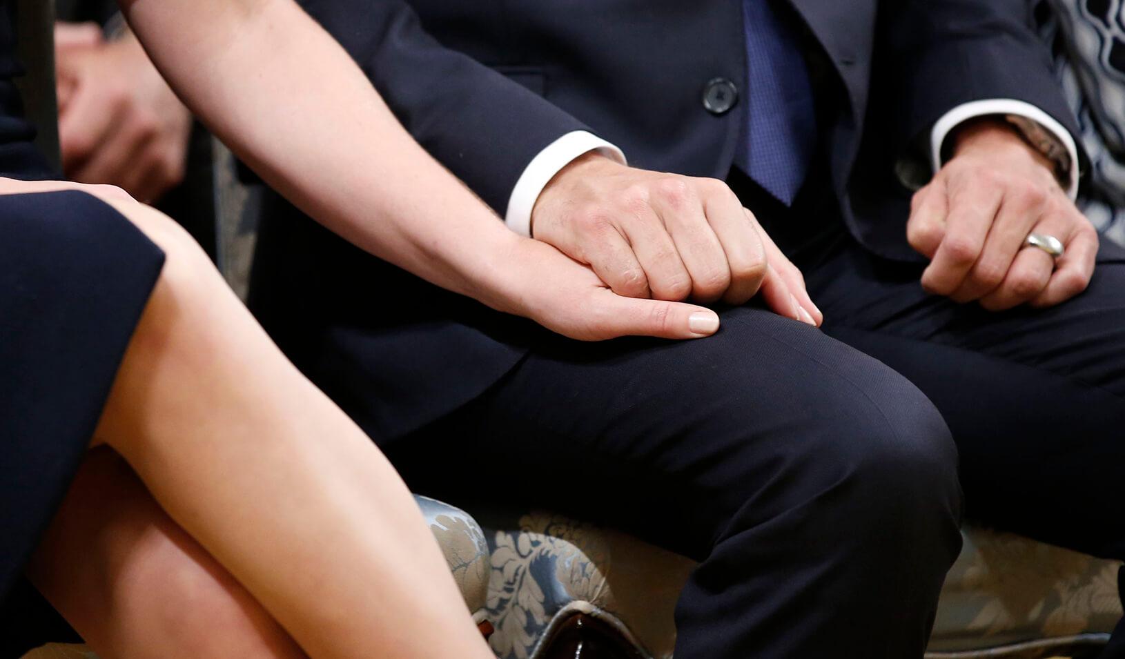A couple holds hands | Reuters/Chris Wattie