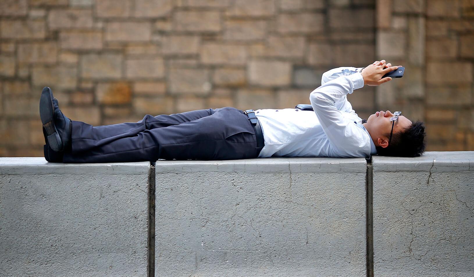 A man watches videos on his phone | Reuters/Damir Sagolj