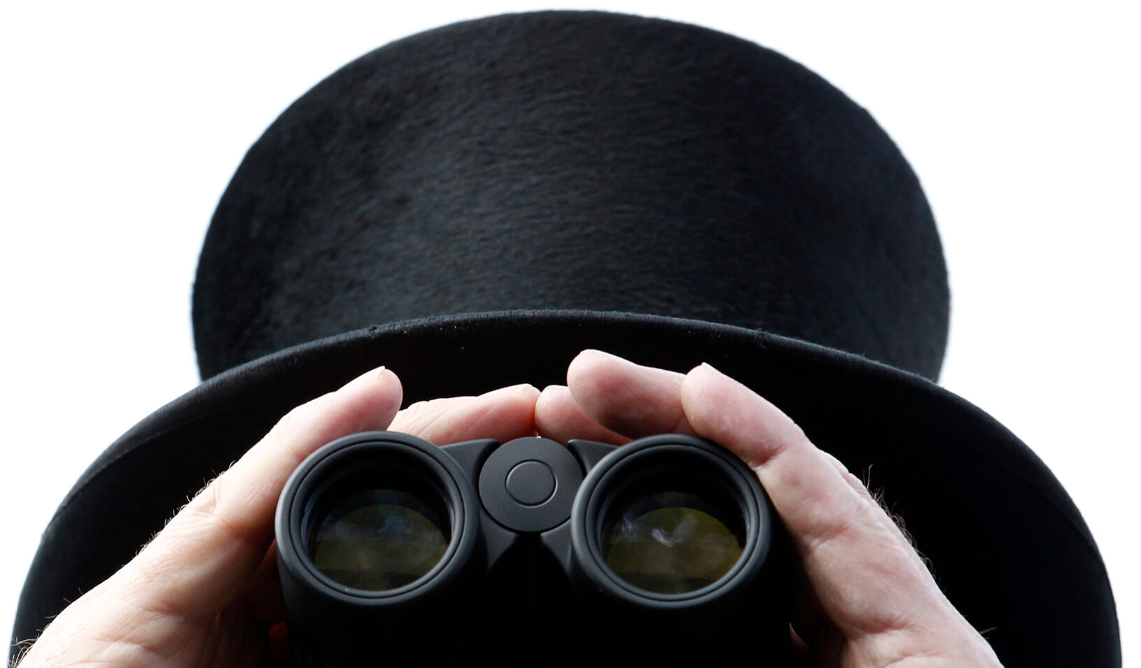 A man looks through binoculars | Reuters/Luke MacGregor