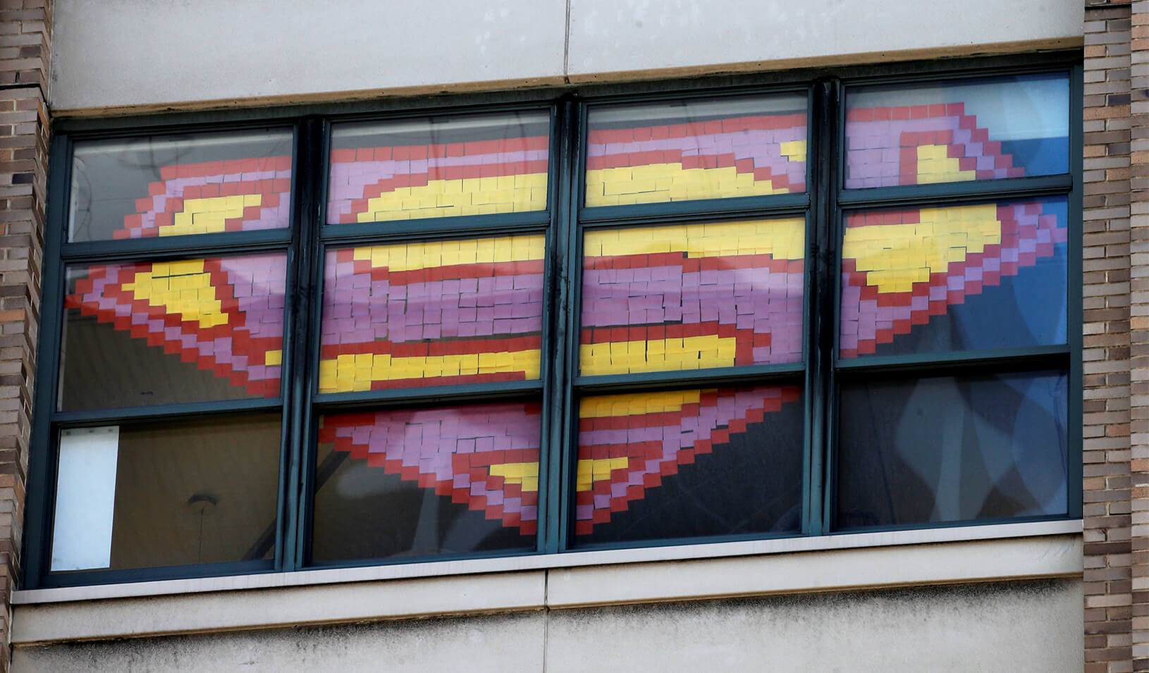 Superman's logo created using sticky notes in a window | Reuters/Mike Segar