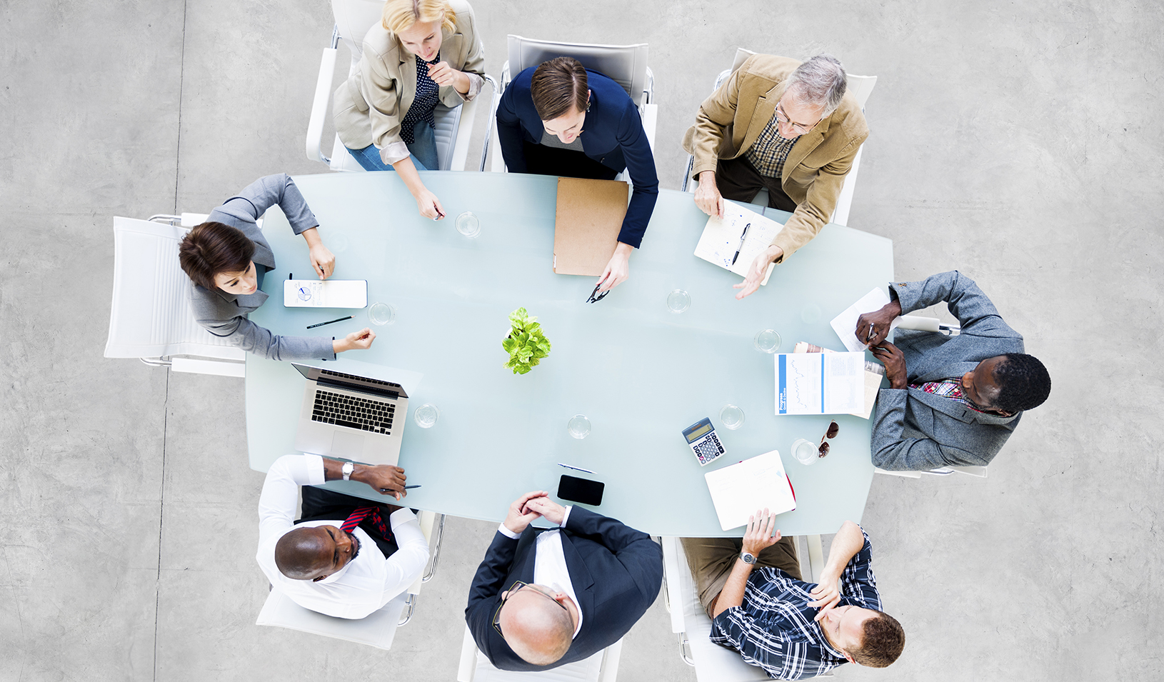 Group of people sitting around a table | iStock/Rawpixel Ltd