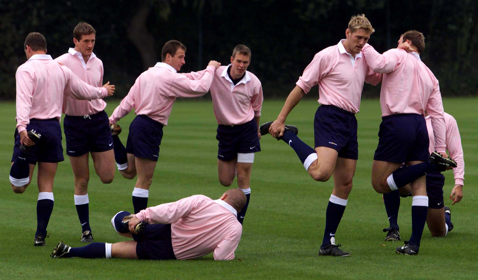 In balletic pose, wearing pink shirts to show their support for the Imperial Cancer Research Fund, the England Rugby union squad go through warm-up exercises.  Russell Boyce/Reuters