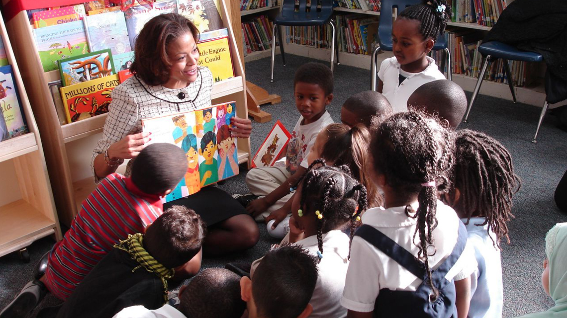 Adult reading to children in library