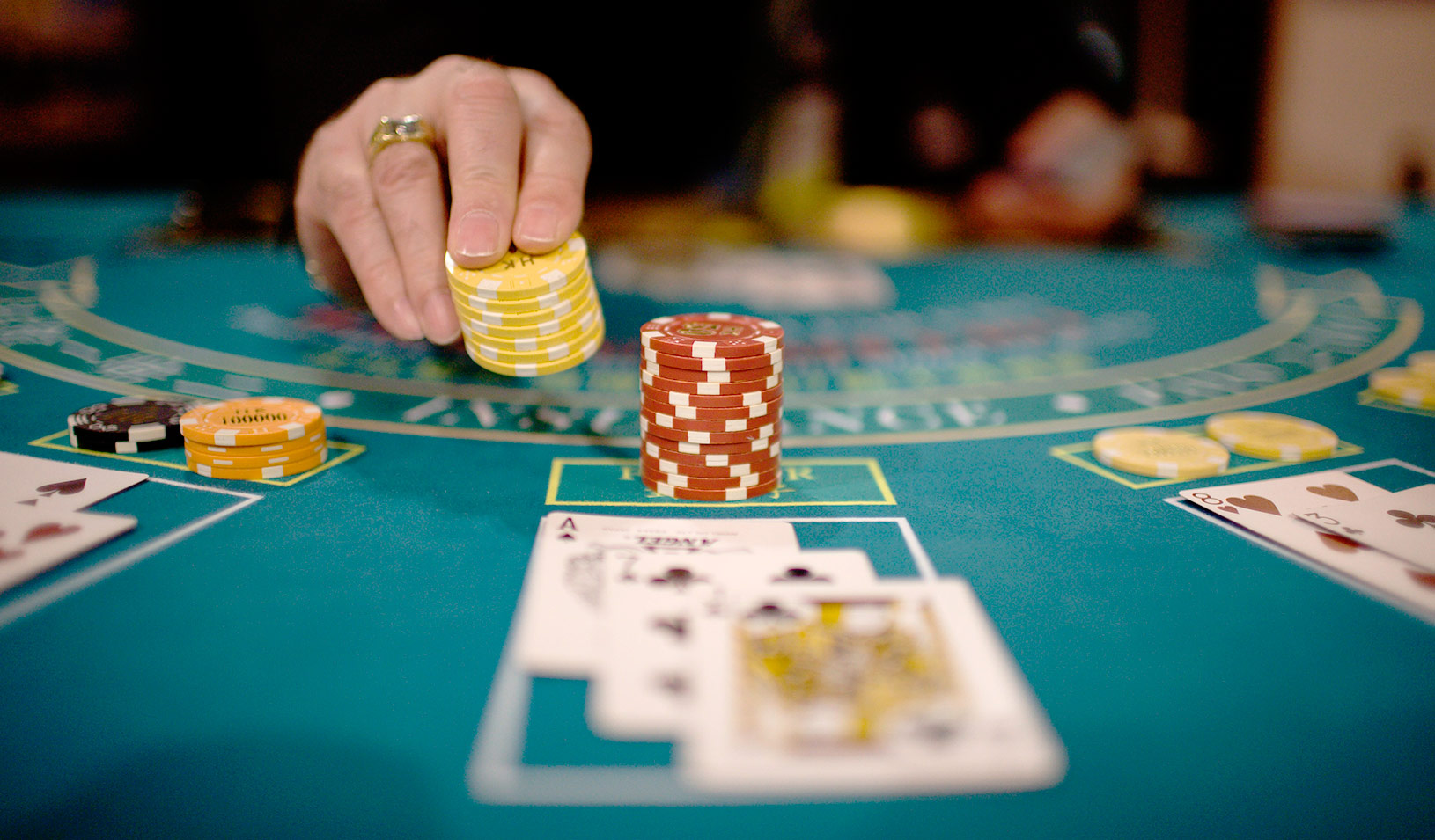 A casino table with cards and chips