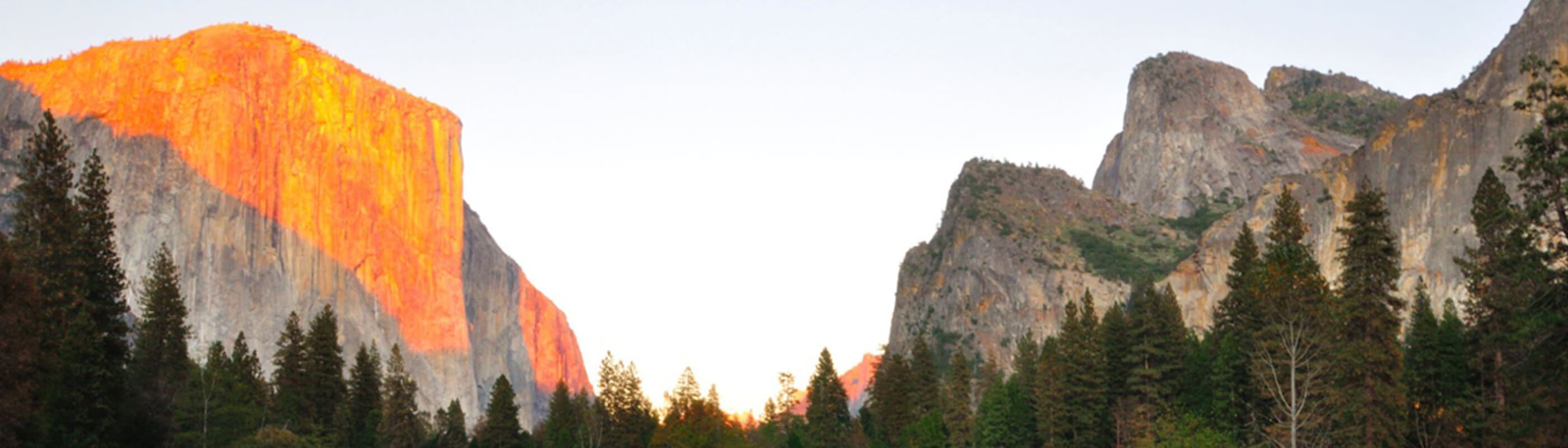 Half dome at Yosemite National Park bathed in orange sunlight