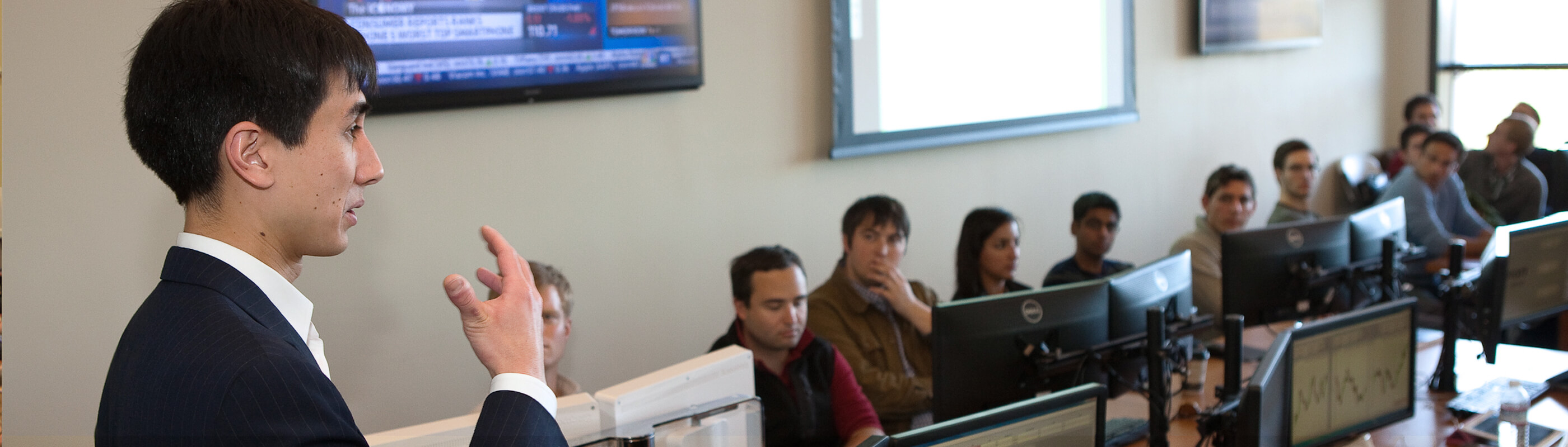 Professor Kevin Mak with students in the Real-time Investment Lab
