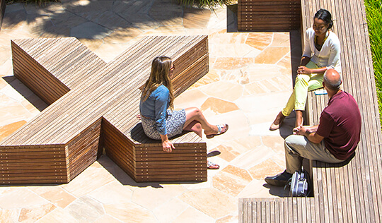 participants sitting in the McCoy Courtyard, Knight Management Center