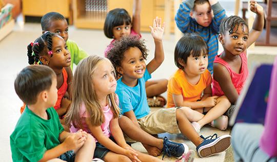 pre-school children learning in class