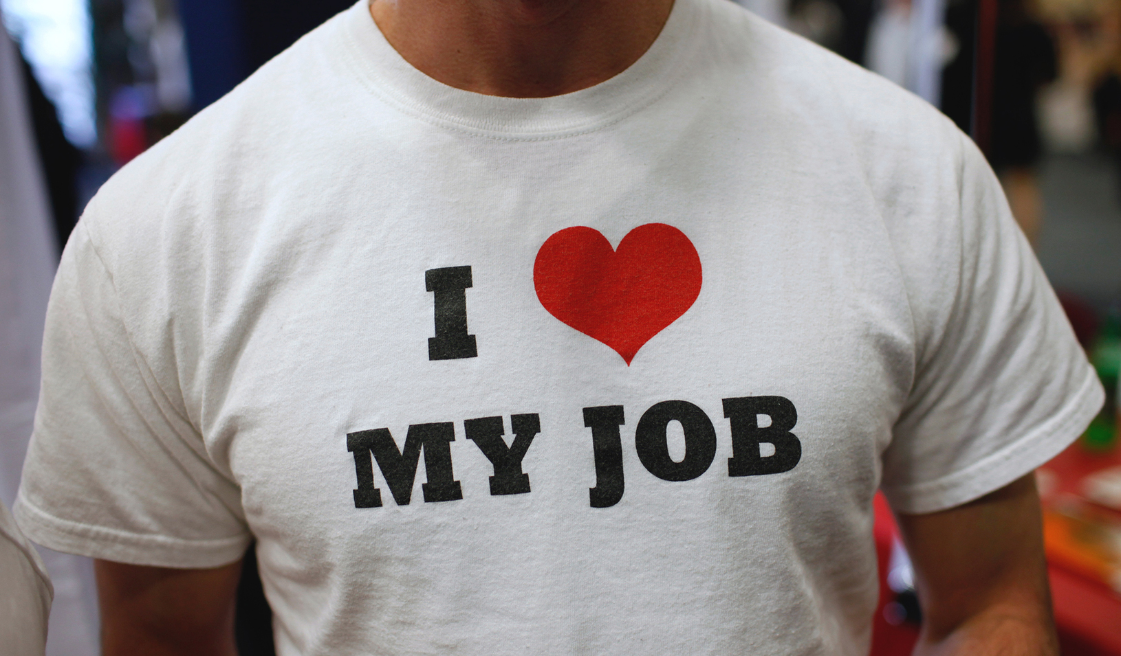 "A t-shirt says ""I love my job"""