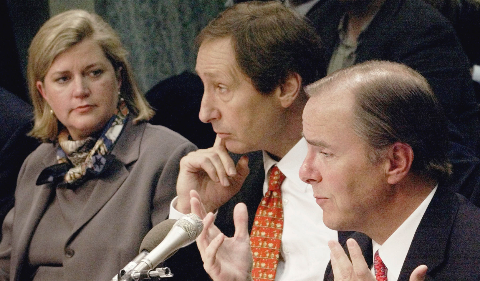 Enron executive Sherron Watkins, left, who objected to a type of fair-value accounting used by the company, looks on in 2002 as former Enron CEO Jeffrey Skilling testifies on Capitol Hill.