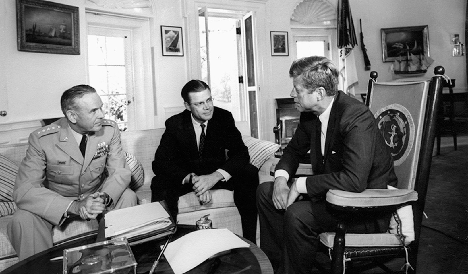 John Kennedy (R) meets with then Secretary of Defense Robert S. McNamara and Chairman of the Joint Chiefs of Staff General Maxwell D. Taylor