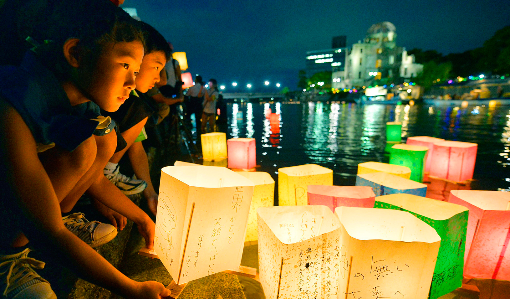 People release paper lanterns  in the river