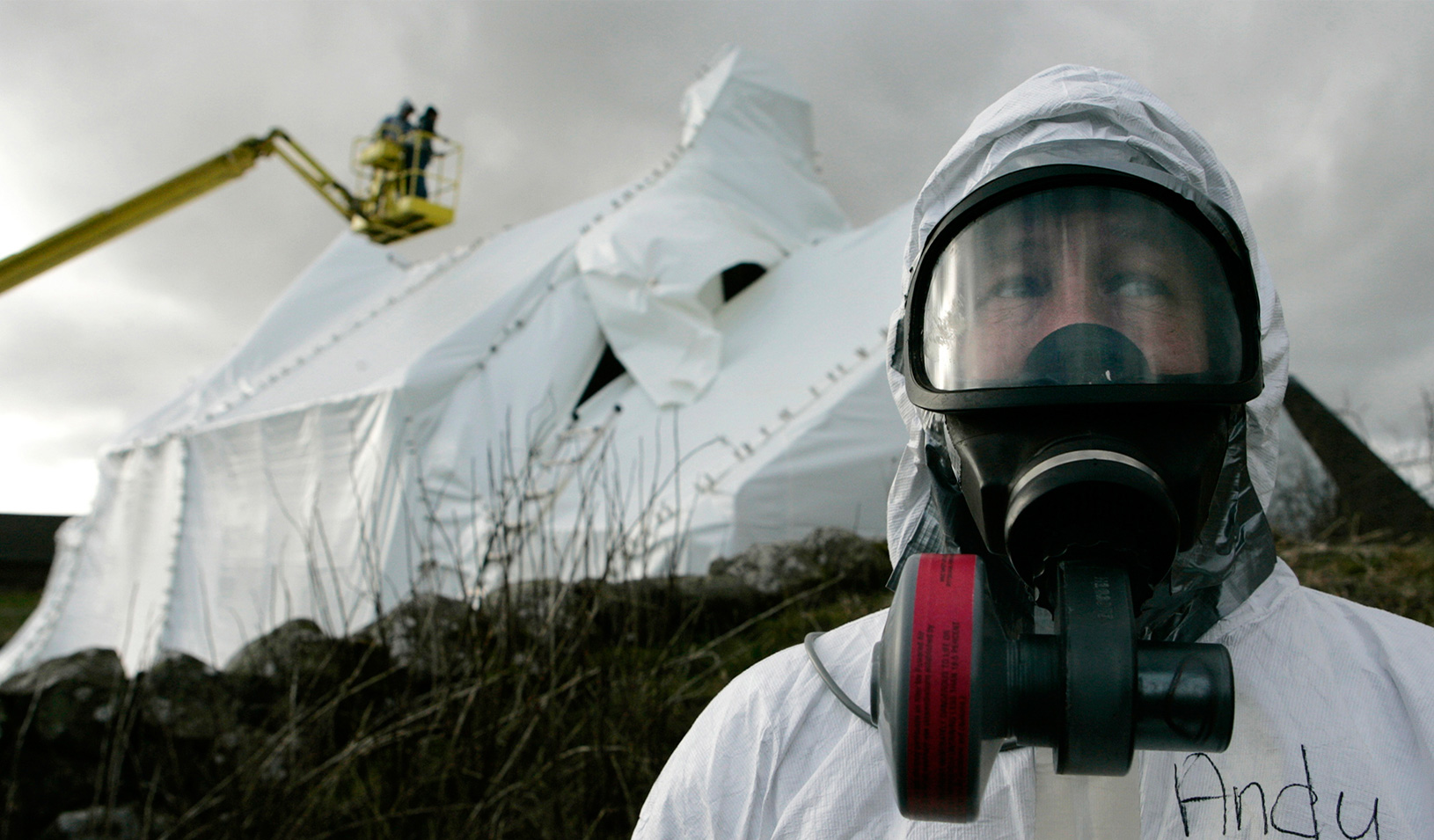 A man wearing protective gear in a decontamination site