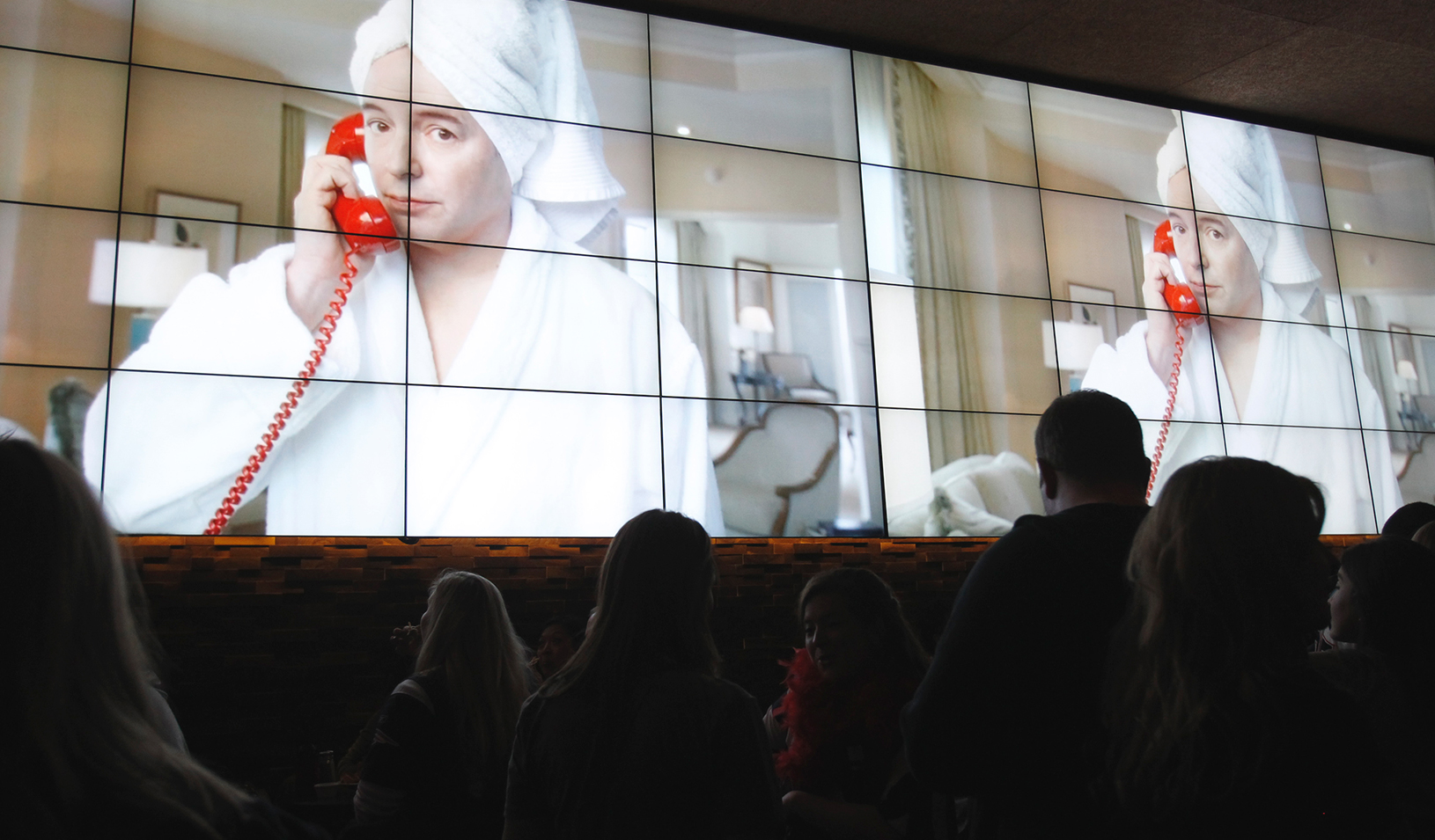 People watching a TV commercial on the big screen