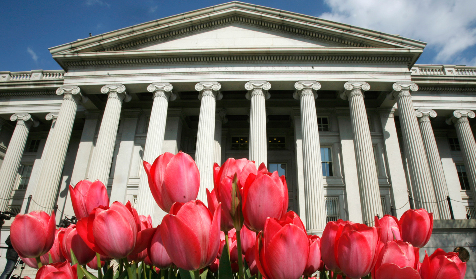 Tulips bloom in front of U.S. Treasury Building in Washington (Reuters photo by Jim Young)