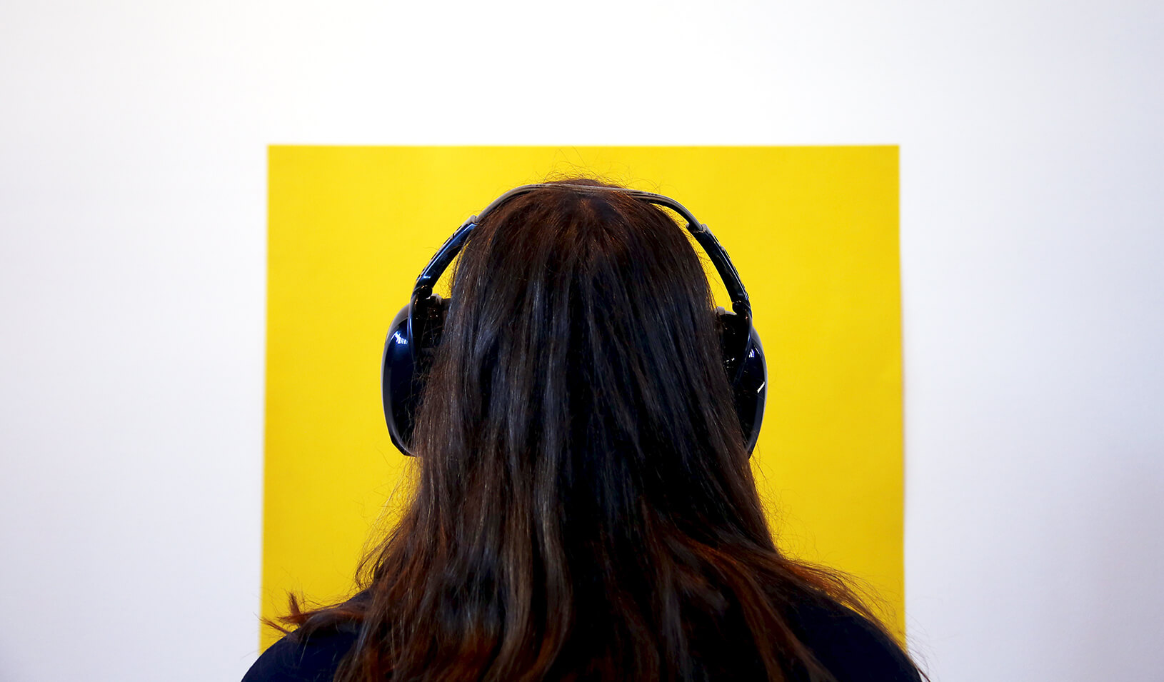 A woman wearing headphones | Reuters/David Gray