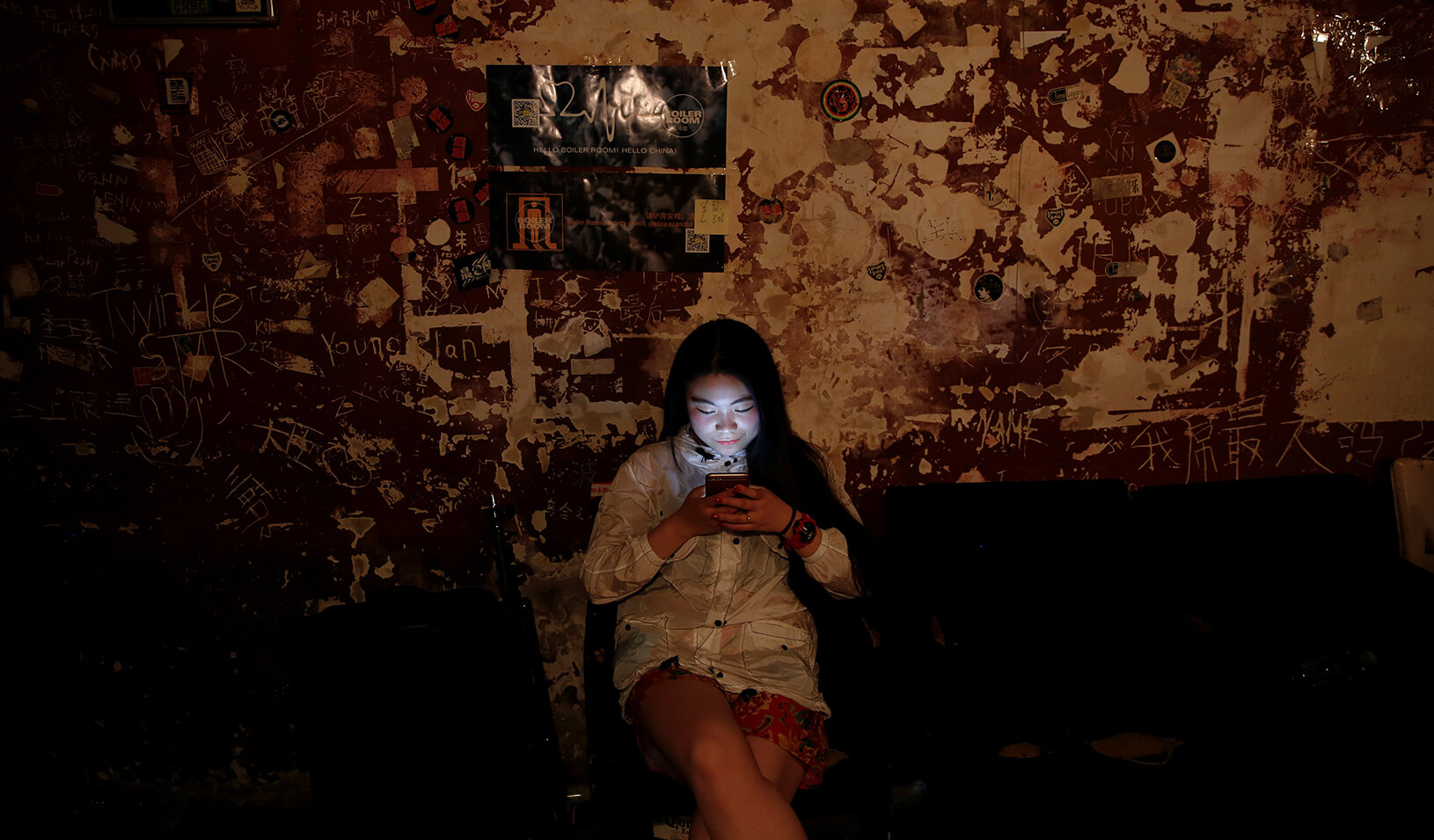 A girl uses her phone. | Reuters/Damir Sagolj