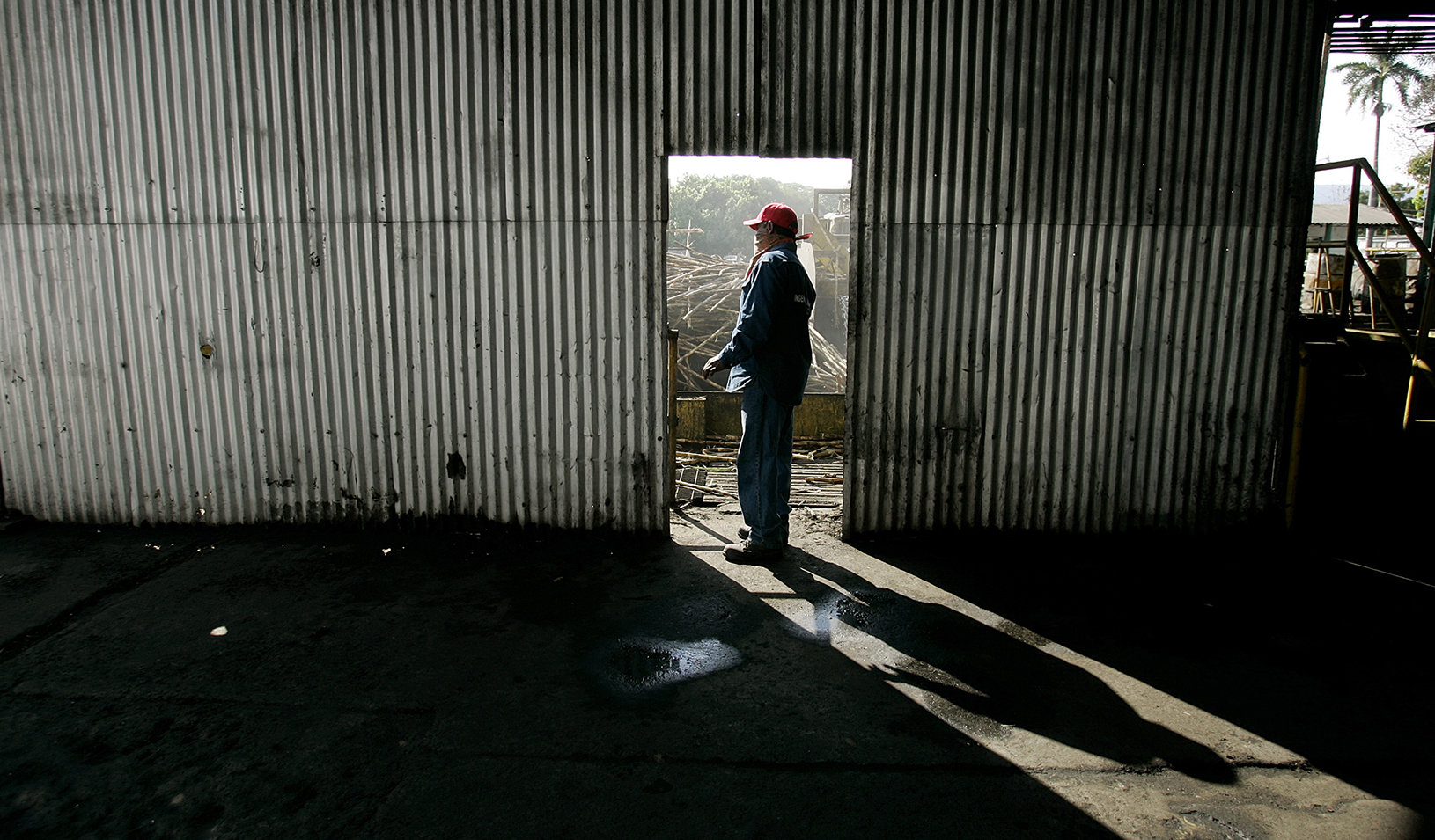 Man standing in doorway of rundown building | Reuters/Andrew Winning