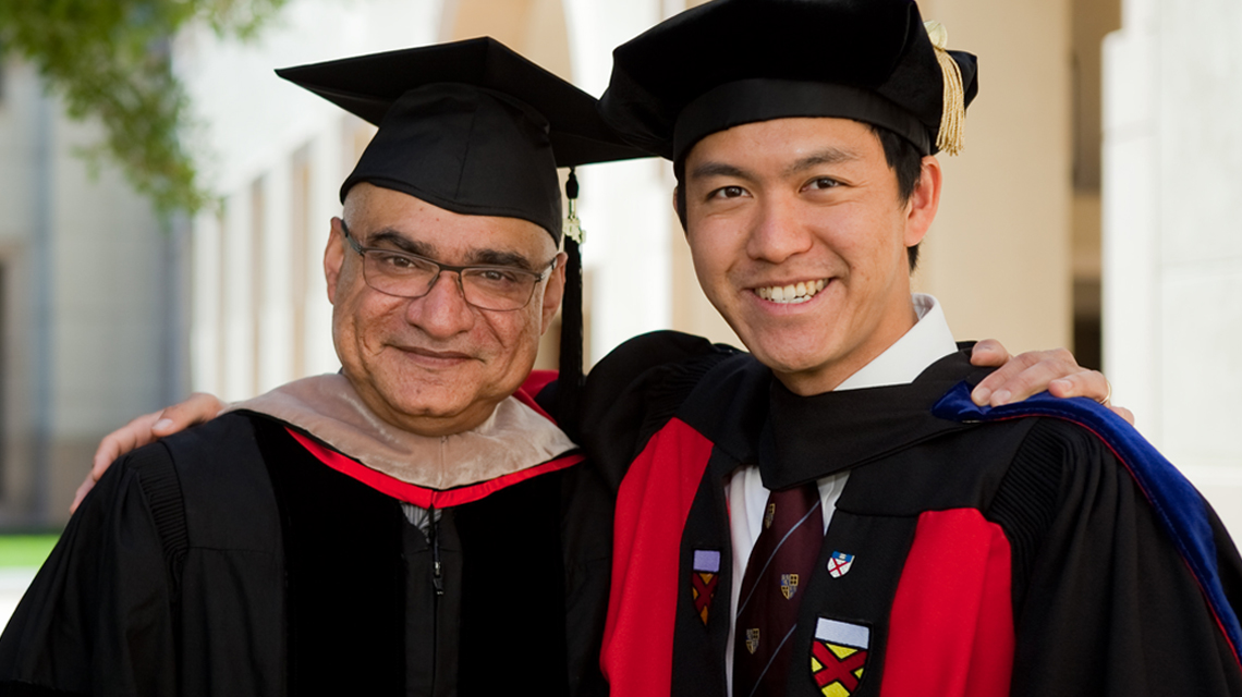 Professor Baba Shiv with PhD graduate at commencement