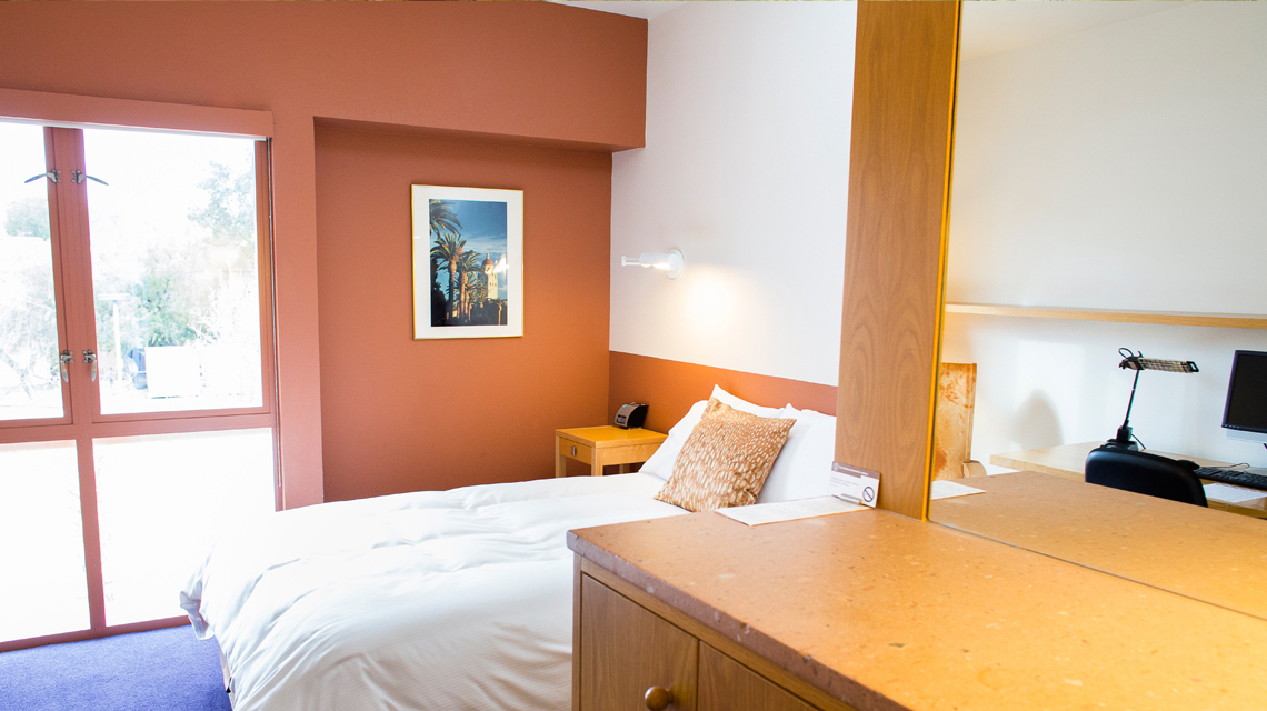 Bedroom of a suite in Schwab Residential Center