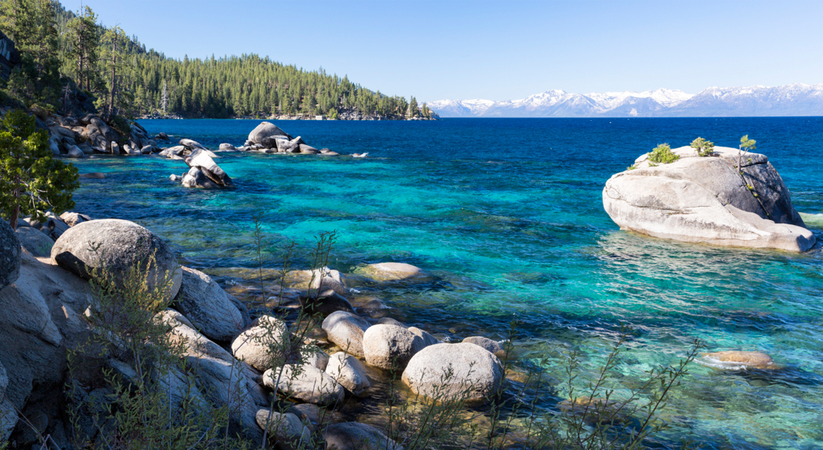 Sparkling Lake Tahoe lapping a rocky beach