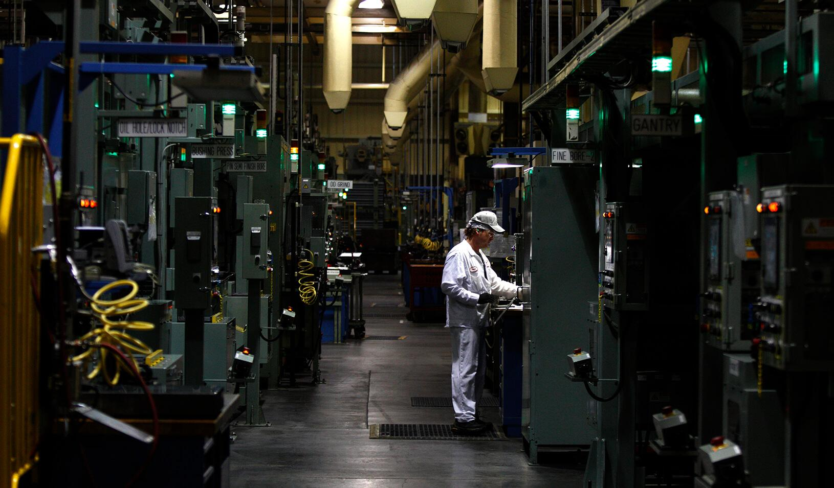 An associate is seen working at an automotive engine plant. Credit: Reuters/Paul Vernon
