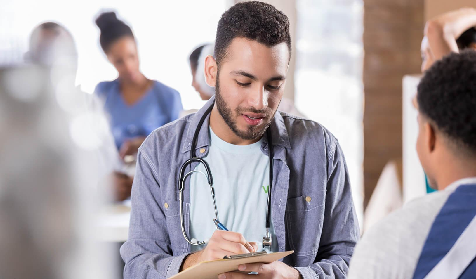 A young doctor performing a wellness check. Credit: iStock/asiseeit
