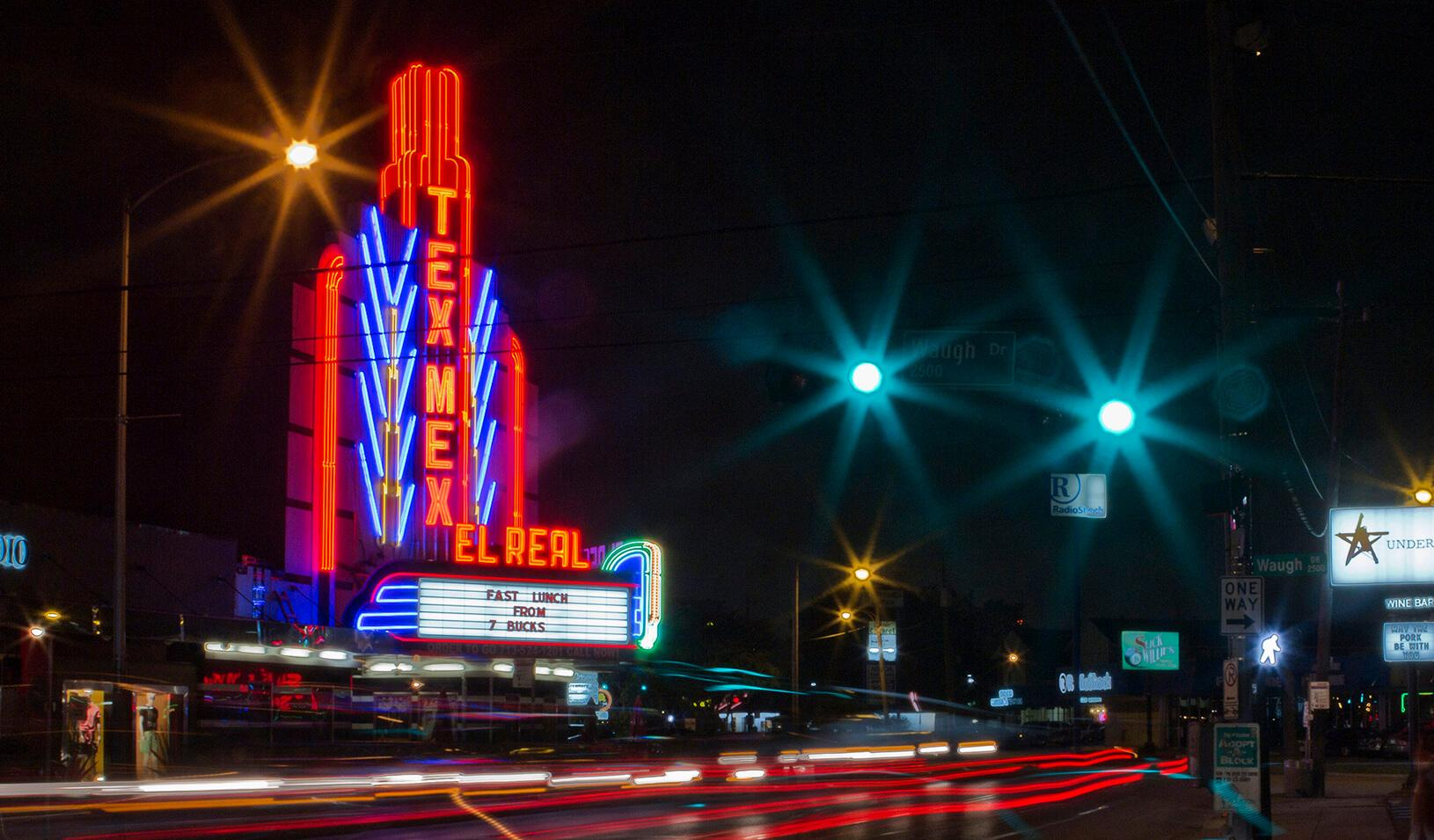 Superstar Chef Bryan Caswell's Tex-Mex food haven El Real occupies a converted movie theatre and lights up Westheimer street in Houston| REUTERS/Richard Carson