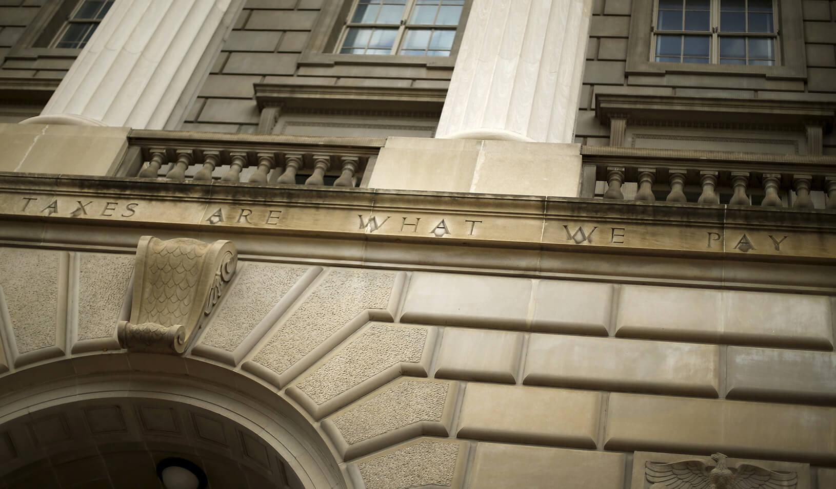 "A general view of the U.S. Internal Revenue Service (IRS) building, with the partial quote ""taxes are what we pay,"" in Washington, D.C."