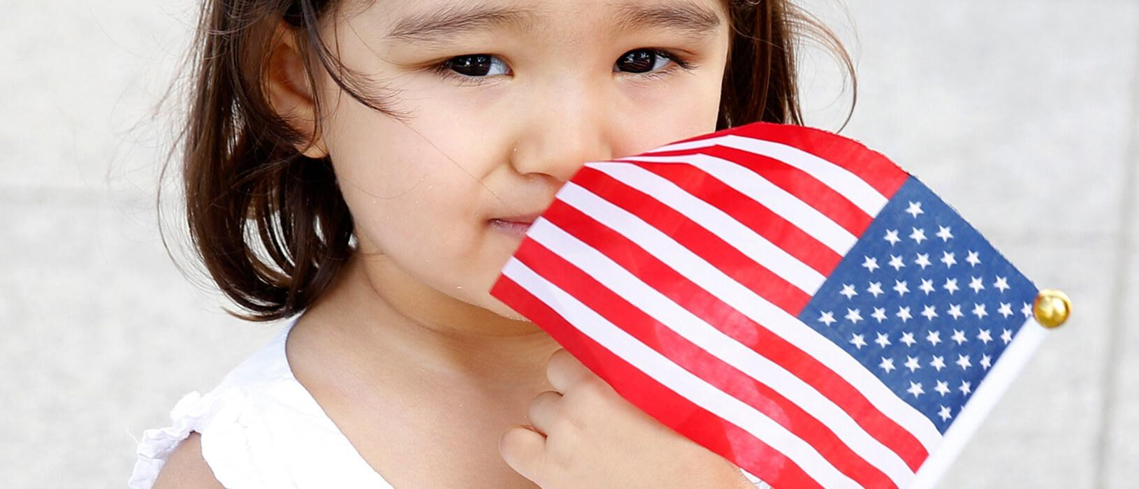 young girl with backwards American flag
