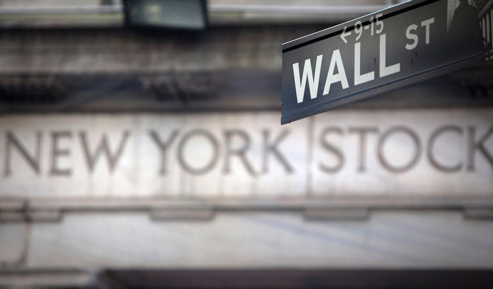 "A ""Wall Street"" sign overlooking the New York Stock exchange"
